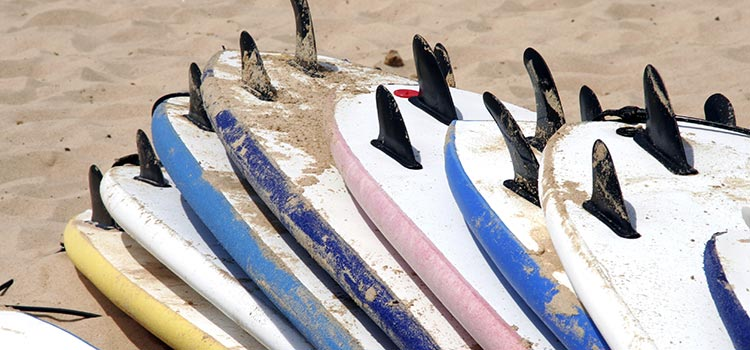 Surf boards piled up on the beach, Bay of Islands