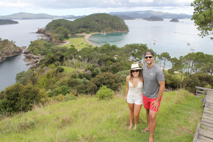 couple walking, bay of islands